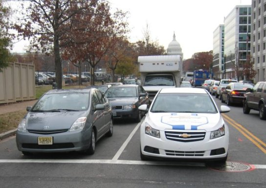 GM Volt and Toyota Prius on streets of Washington D. C.