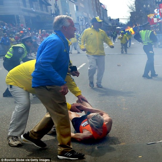 marathon_runner_hit_by_bomb_on_videos