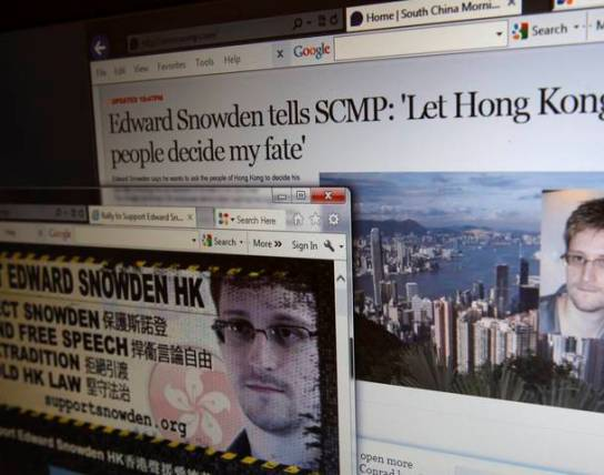 Interview of Snowden in South China Morning Post and webpage supporting Snowden are displayed on a computer screen in Hong Kong