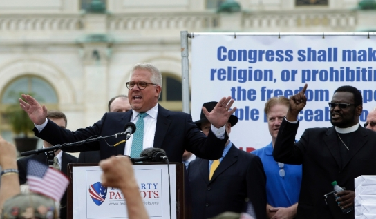 "Glenn Beck addresses the crowd during a Tea Party rally to ""Audit the IRS"" in front of the U.S. Capitol in Washington"