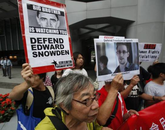 Protesters supporting Snowden march to the U.S. Consulate in Hong Kong