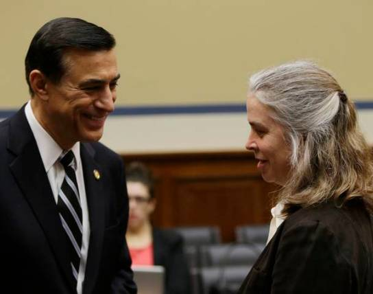 IRS Sarah Hall Ingram chats with Rep Issa before Committee on Oversight and Government Reform on Capitol Hill in Washington